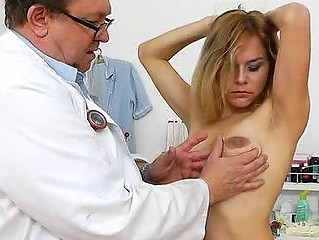 Blonde slut gets toyed by her doctor in his office
