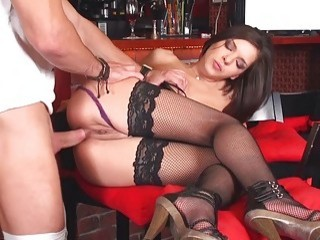 Sweet brunette enjoys a hot anal stockings action
