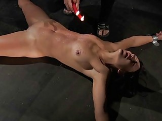 Redhead gets candle wax on her pussy has orgasm